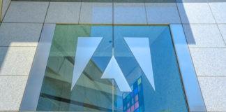 Adobe palace window with logo.