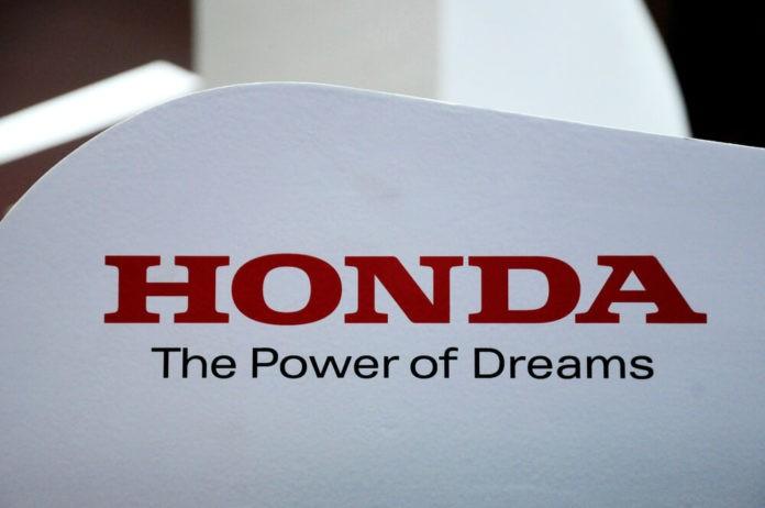 HONDA brand emblem and logos at the car body.