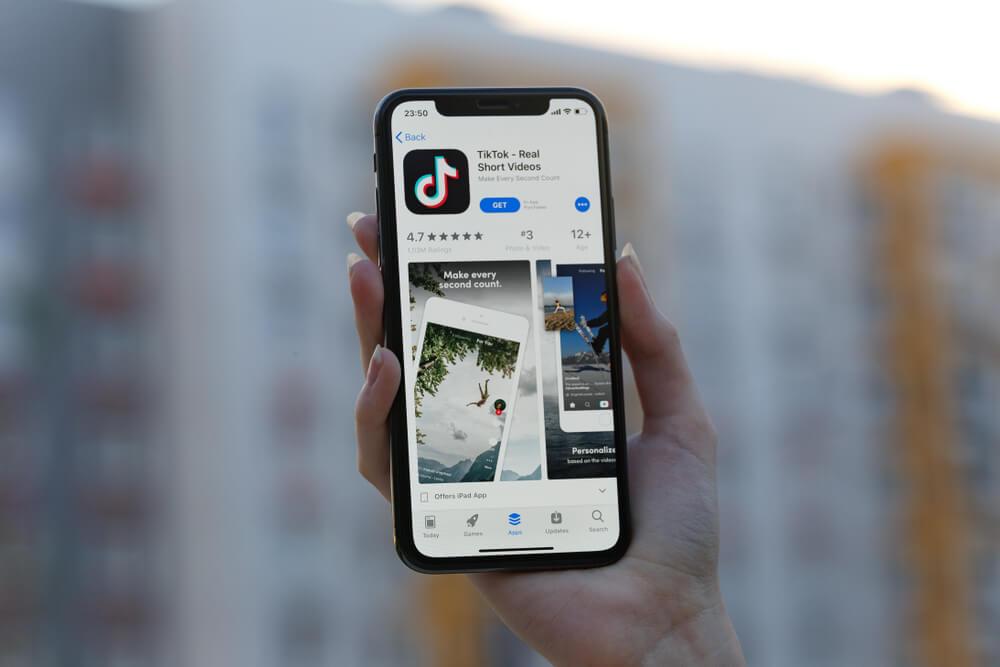best - App Header Image Alt-Tag: Tik Tok application icon on smartphone.