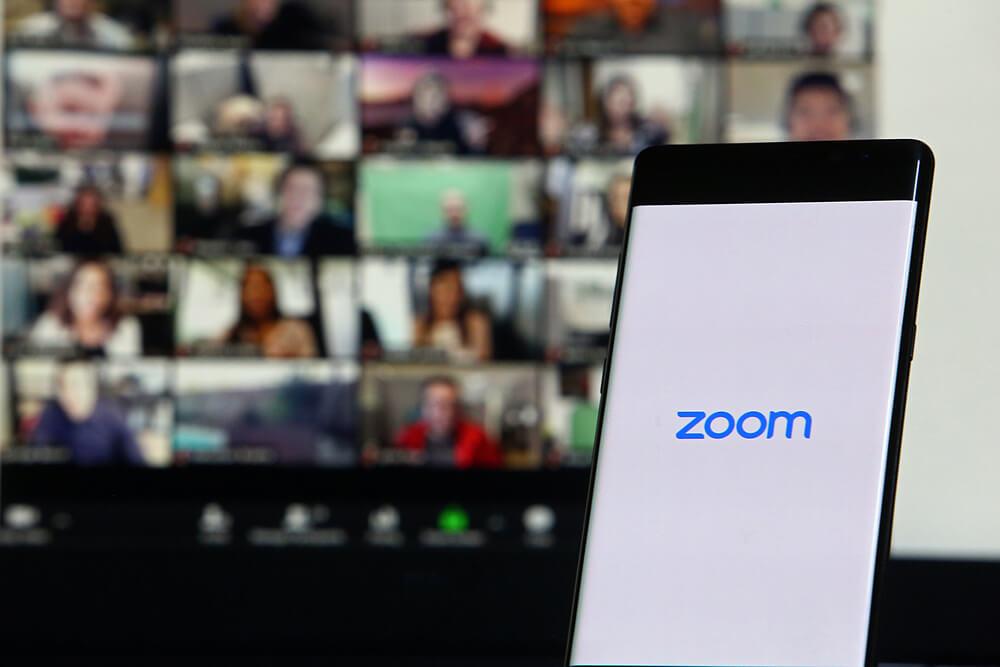 Smartphone showing Zoom Cloud Meetings app.