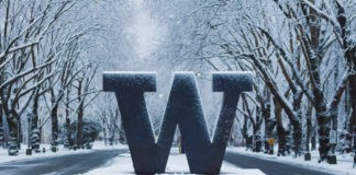 University of Washington welcome sign under snow.