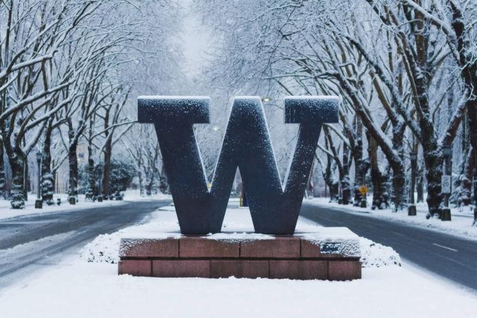 University of Washington welcome sign under snow.