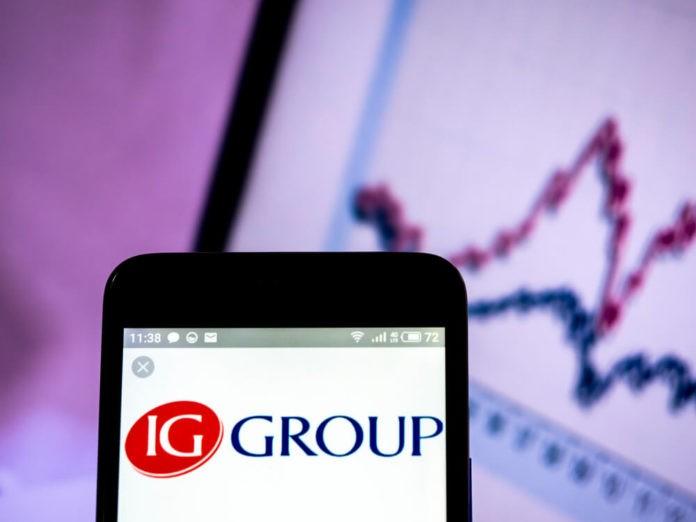 IG Group Holings plc logo seen displayed on smart phone.