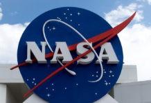 NASA logo with blue cloudy sky background