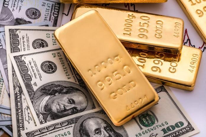 Gold Up, Strengthening Dollar, Presidential Debate