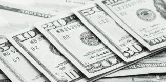 Close up views of dollar banknotes.