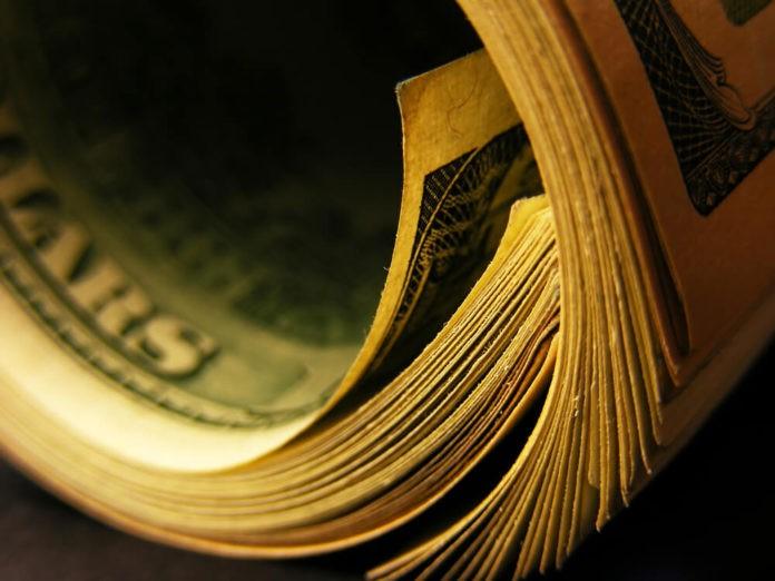 US dollars roll close up photo