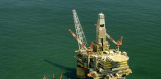 Oil falls under $66