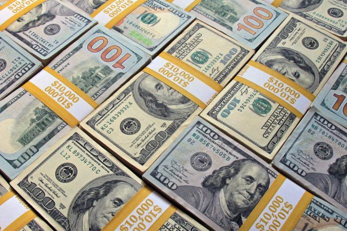 USA Jobs: US dollar bills stacked and organized.