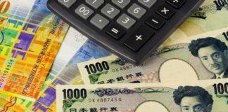 Washington: Japanese yen and Swiss franc bills and a calculator.