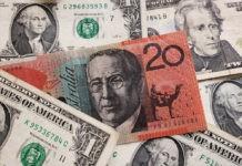 The Greenback: US dollar and Australian dollar banknotes.